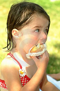 girl eating cupcake