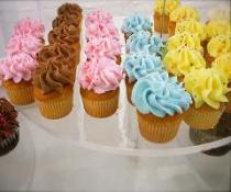 cupcakes with yellow, brown, pink and blue frosting