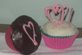 Valentines day cupcakes with pink chocolate hearts